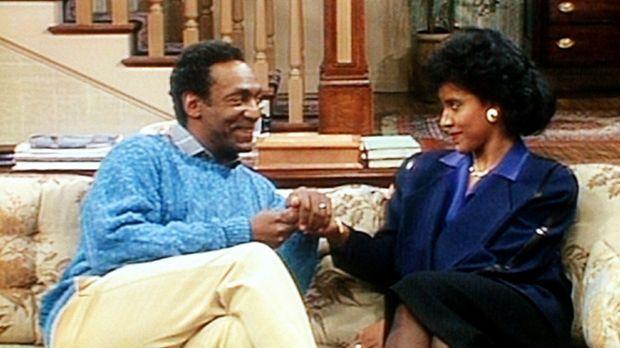Cliff (Bill Cosby, l.) versucht, seiner Frau Clair (Phylicia Rashad, r.) zu e...