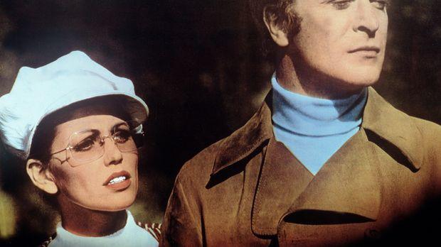 Ahnt Lorna (Margaret Blye, l.), dass Charlie (Michael Caine, r.) ein bekannte...