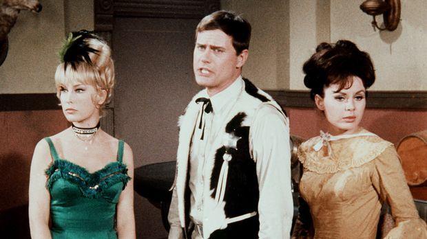 Jeannie (Barbara Eden, l.) versetzt sich mit Tony (Larry Hagman, M.) in den W...