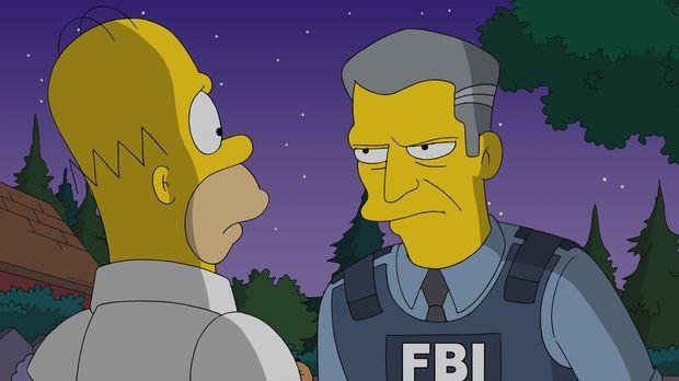 Detective Gratman (r.) vom FBI will Homer (l.) einbuchten, weil der einen Fil...