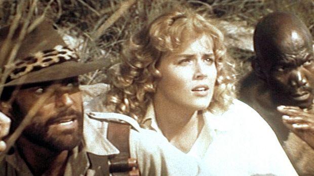 Quartermain (Richard Chamberlain, l.), Jessie (Sharon Stone, M.) und Umbopo (...