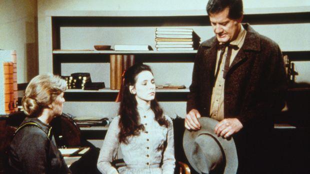 Victor Crosby (Jim Antonio, r.) möchte Annie Crane (Madeline Stowe, M.) dazu...